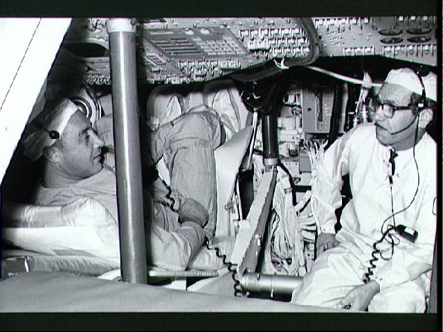Virgil I. Grissom inspecting his Apollo 1 space vehicle.