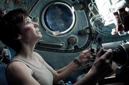 Astronaut Ryan Stone (Sandra Bullock) is inside of a Russian Soyuz space vehicle