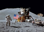 Astronaut James Irwin salutes the American flag during Apollo 15 mission.