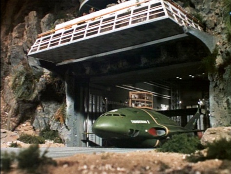 Thunderbird 2 leaves hanger.